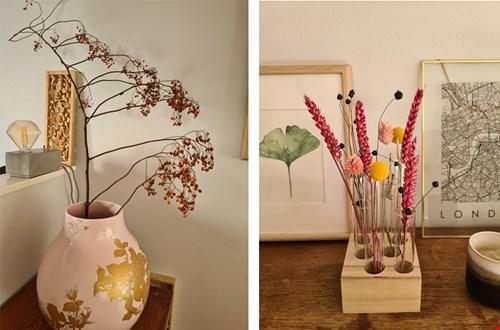 Een mooie, enkele herfsttak of verschillende droogbloemen in warme kleuren bij elkaar