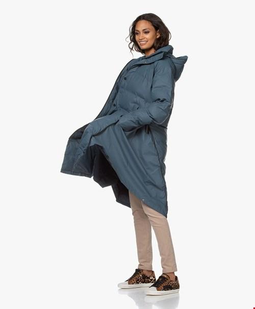Van regenjas naar poncho naar pufferjas naar dekbed!